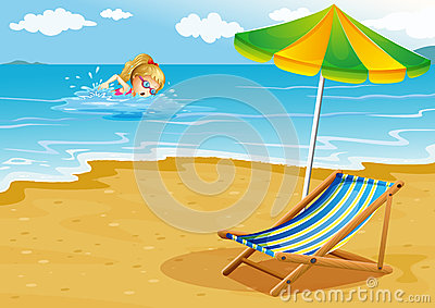 A girl swimming at the beach with a chair and an umbrella at the