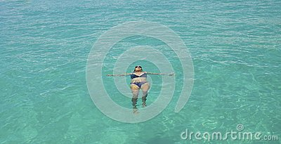 Girl swimming in the clear blue sea