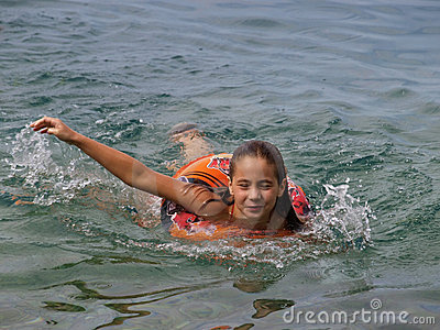 Girl swimming with float ring