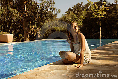 Girl and swimming pool