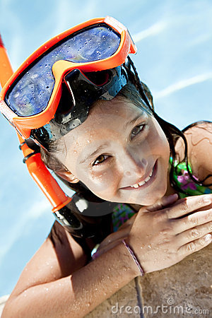 Girl In A Swimming Pool with Goggles and Snorkel