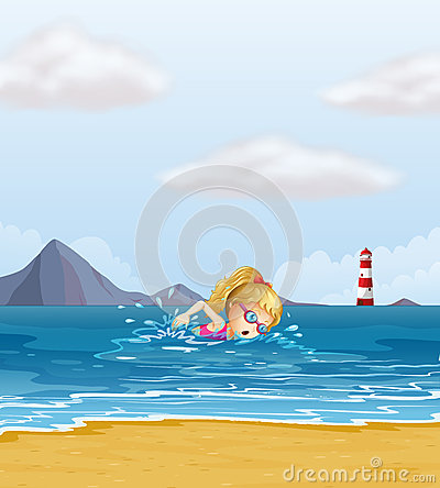 A girl swimming at the sea with a beacon at the back