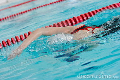 Girl swimming stroke or crawl face down