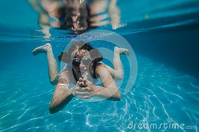 Girl Swims Goggles Underwater
