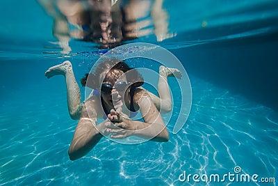 Girl Swims Goggles Underwater