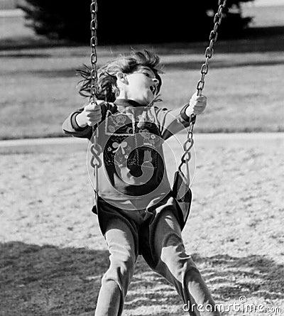 Girl On Swing Having Fun
