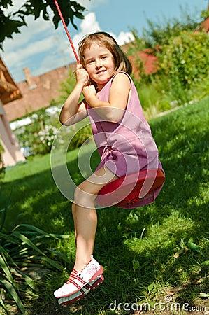 Girl swinging on seesaw