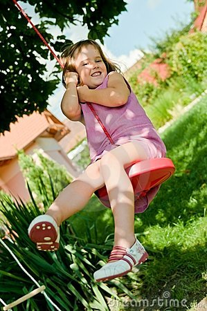 Girl swinging on seesaw