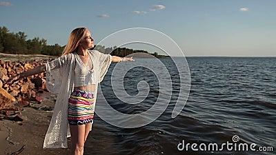 Girl takes deep breath enjoying fresh air on beach stock video footage