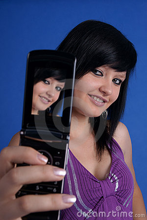 Girl taking auto portrait using mobile phone