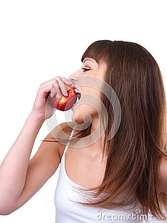 Girl taking a bite of an apple.