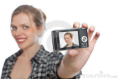 Girl taking a photo of herself with a digi camera