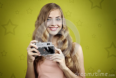 Girl taking photo with retro camera