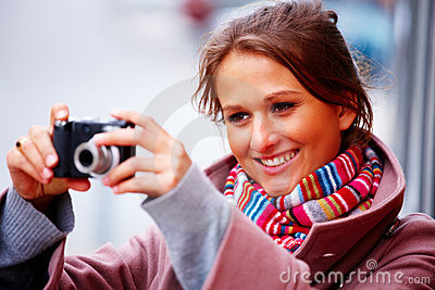 Girl taking photographs on her digital camera
