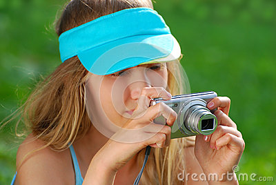Girl taking photos by digital camera