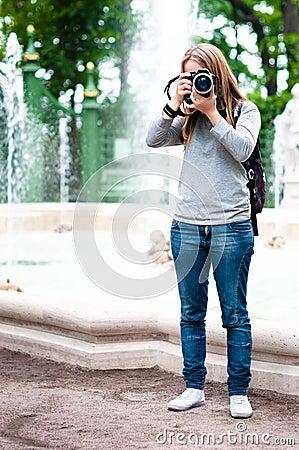 Girl taking photos during travel