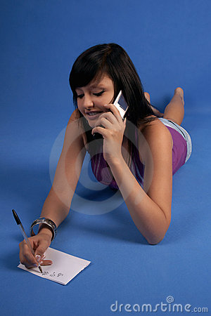 Girl talking on mobile phone smiling