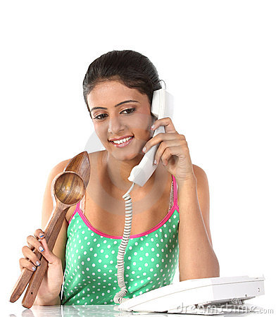Girl talking over telephone with wooden sticks