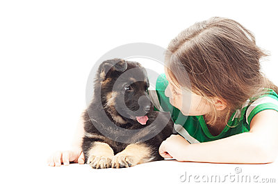 girl talking with a puppy