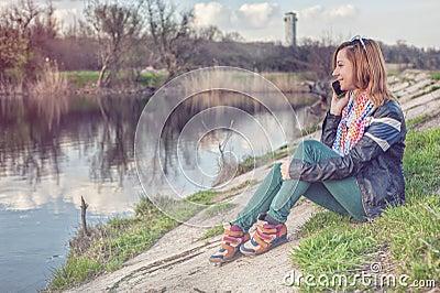 Girl talking to phone Stock Photo