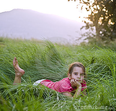 Girl in tall grass