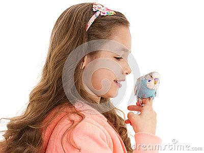 Girl with tame pet bird budgerigar