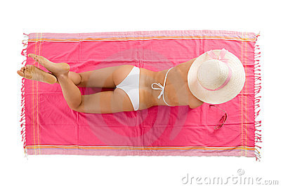 Girl tanning lying on the beach towel