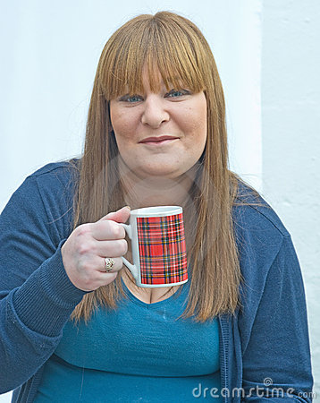 Girl With Tartan Mug. Stock Photos - Image: 22997993
