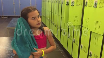 Girl Teenager In The Locker Room Wipes Himself With Slow Motion Video A Towel. Booths For Changing Clothes After The Stock Video - Video of booth, towel: 99682101