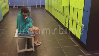 Girl Teenager In The Locker Room Wipes Himself With A Towel. Booths For Changing Clothes After The Pool Slow Motion Stock Video - Video of shop, sport: 99684025