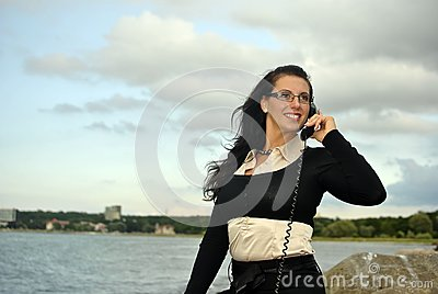 Girl with a telephone receiver in hand
