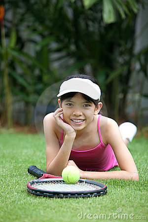 Girl with a tennis racket and tennis ball