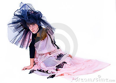 Girl in theatrical costume sitting overwhite