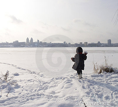 Girl at thebank of frozen river