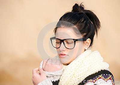 Girl with thick-rimmed glasses