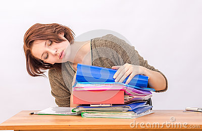 Girl thoughtfully office employee goes through a stack of folders Stock Photo