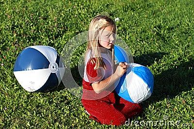 Girl with three balls