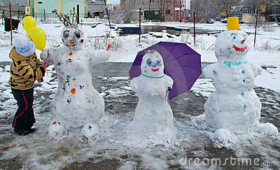 Girl and three snowman