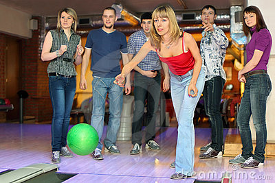 Girl throw ball for bowling, friends worry for it