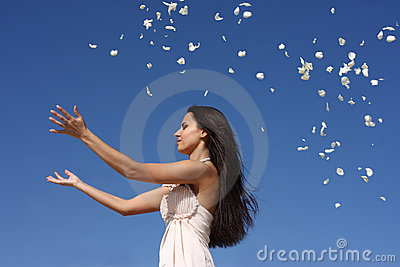 Girl throwing petals