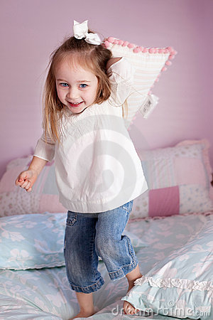 Girl throwing a pillow
