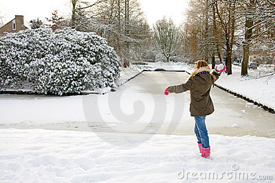 Girl is throwing snow ball