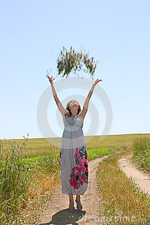 The girl throws upwards a bunch of flowers