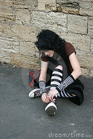 Girl tie up her laces
