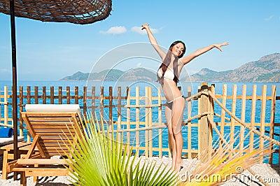 Girl on tiptoes enjoys sun and sea