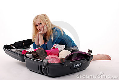 Girl to packing one's things into a suitcase