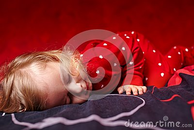 Girl toddler dressed in her pajamas sleeping