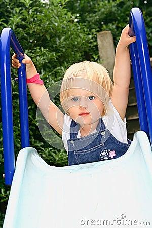 Girl toddler on top of slide