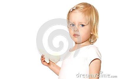 Girl toddler in white vest