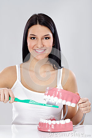 Girl with toothbrush and jaws
